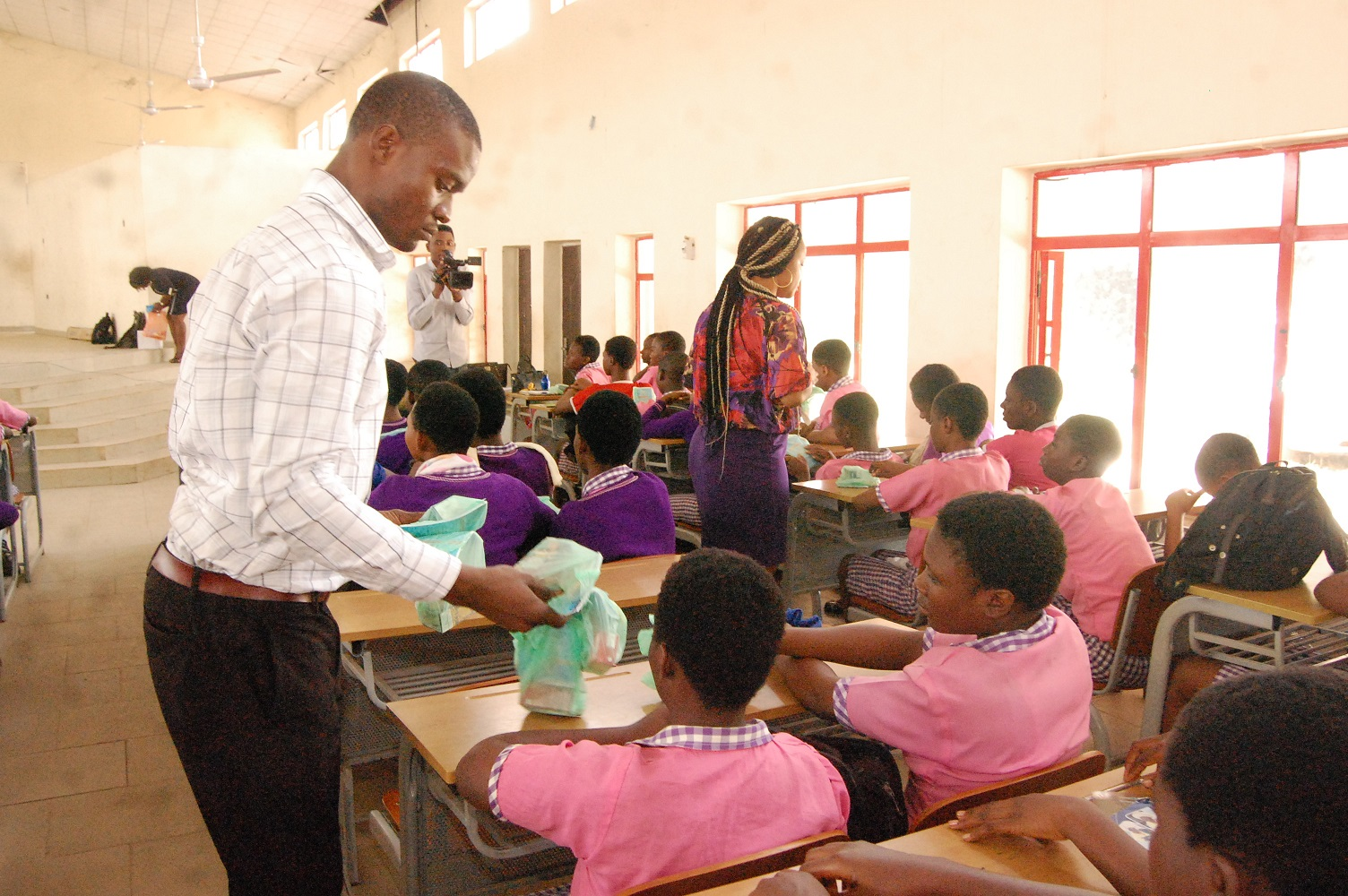 Distribution of souvenirs to the students