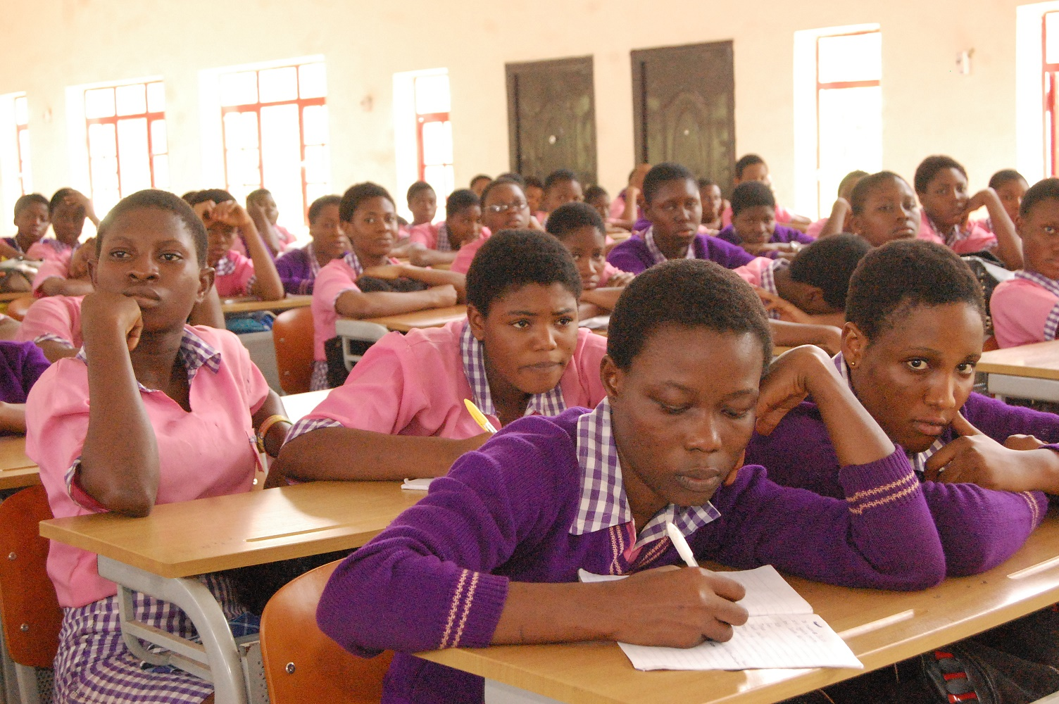 Idia College students taking notes during the presentations.